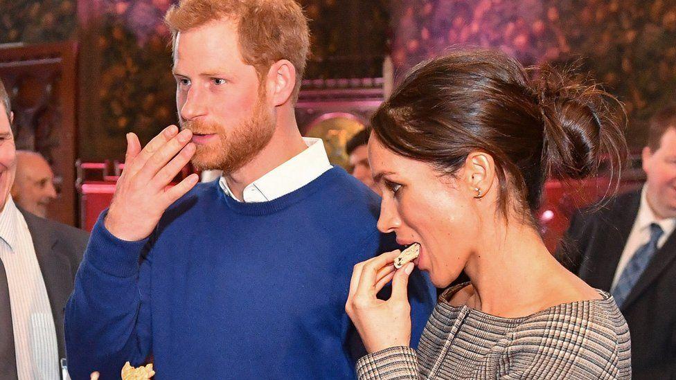 Prince Harry and Meghan Markle enjoy a Welsh cake