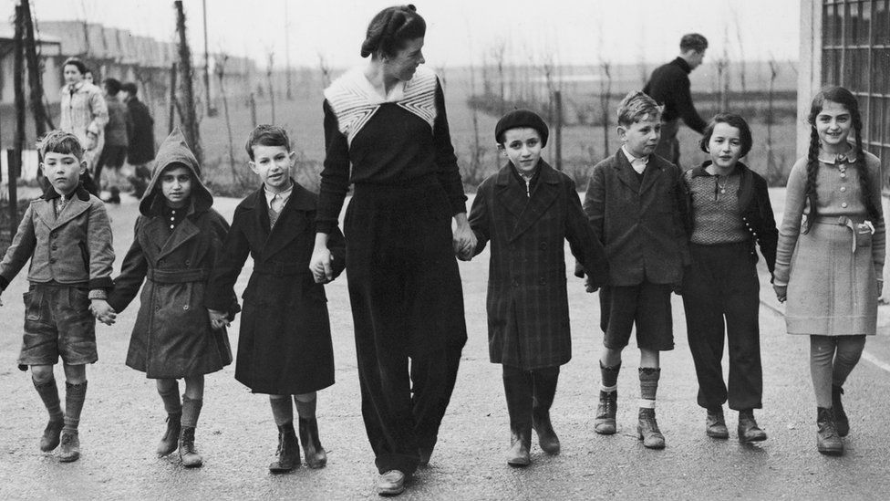 Miss W. Herford takes a group of Jewish refugee children for a walk at Dovercourt camp near Harwich