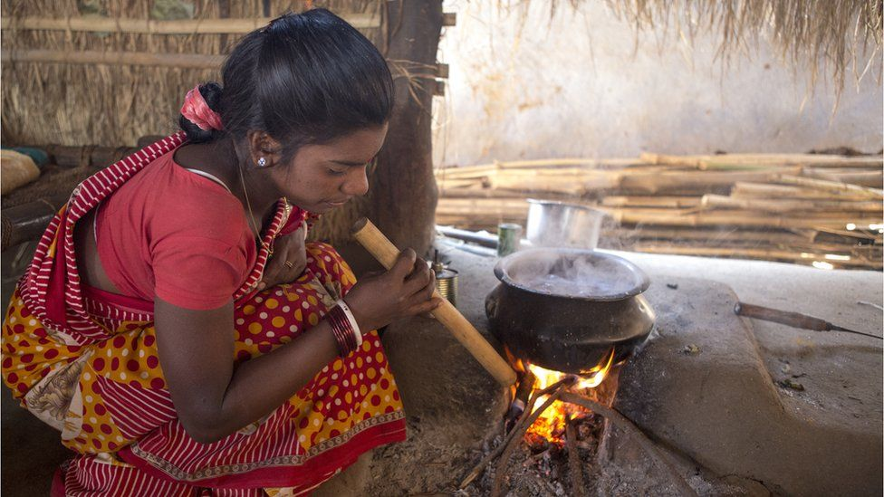 Woman cooking with firewood in India