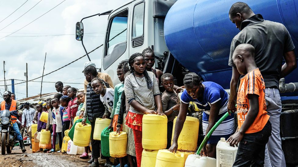 People line up with jerry cans in Kibera, Nairobi, Kenya - Wednesday 8 April 2020