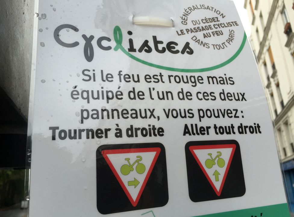 """New sign in Paris that reads: """"If the light is red but equipped with one of these two panels, you can: Turn right; Go straight on"""""""