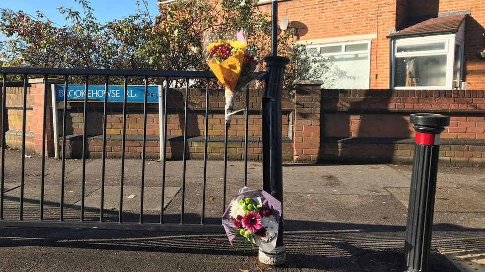 Flowers left at scene in Randlesdown Road in Bellingham, south-east London