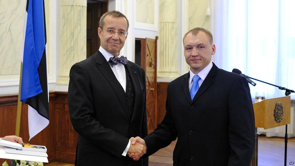Estonian security service officer Eston Kohver, right, receives decoration from the Estonian President Toomas Hendrik Ilves, left, in February 2010