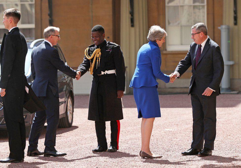Theresa May arrives at Buckingham Palace