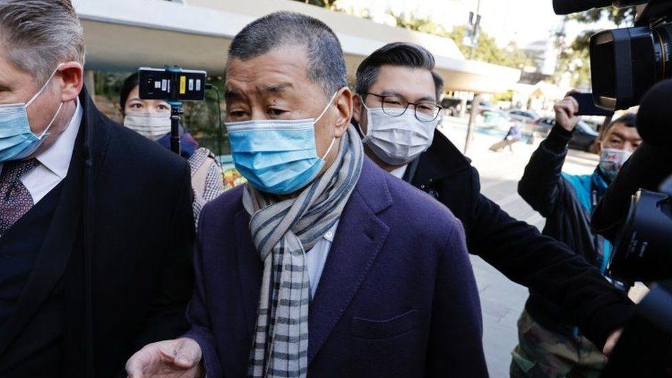 Jimmy Lai arrives at court on December 31