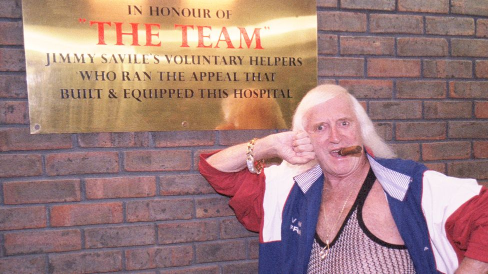 Savile in 2003 outside Stoke Mandeville Hospital