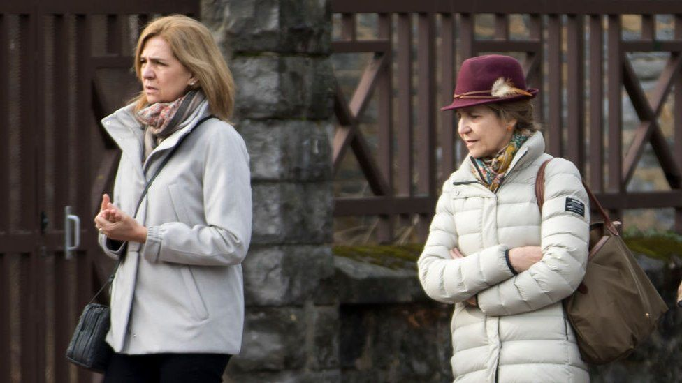 Princess Cristina of Spain (L) and Princess Elena of Spain (R) are seen in December 2017 file photograph wearing outdoor clothes