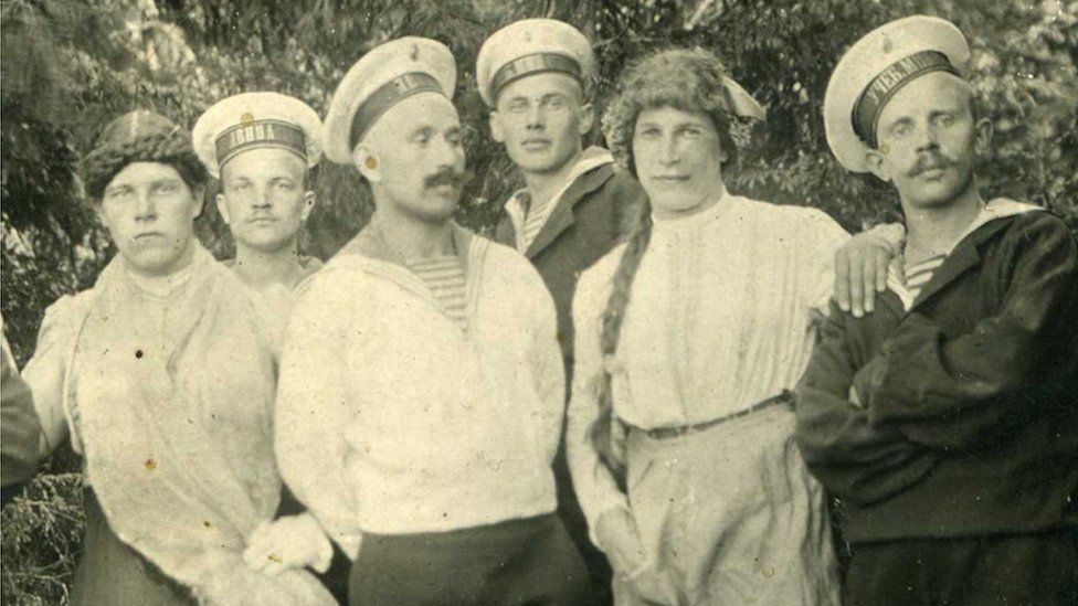 Russian sailors with young men dressed in women's clothes, 1916