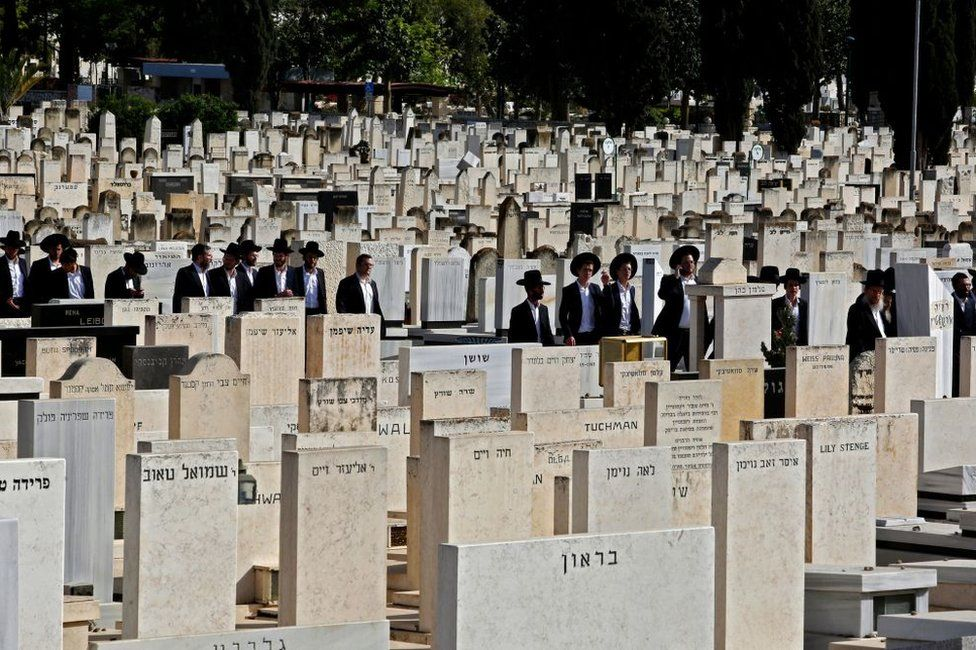 Ultra-Orthodox Jews attend the funeral of one of the victims of Meron stampede at Segula cemetery in Petah Tikva on April 30, 2021
