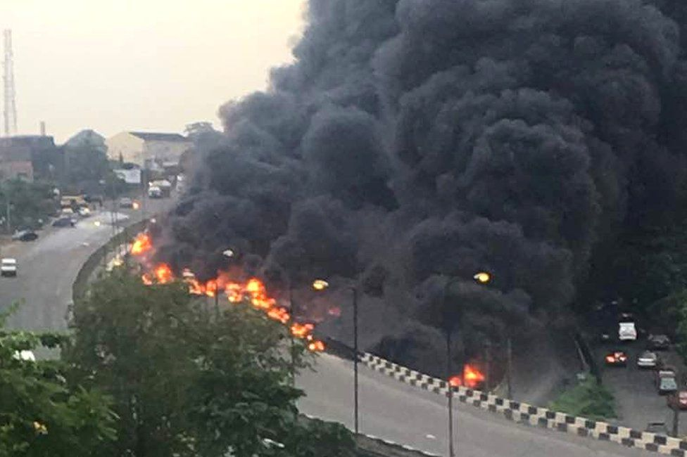 Smoke and flame rise after an oil tanker truck caught fire in Nigeria's commercial capital Lagos, 28 June 2018