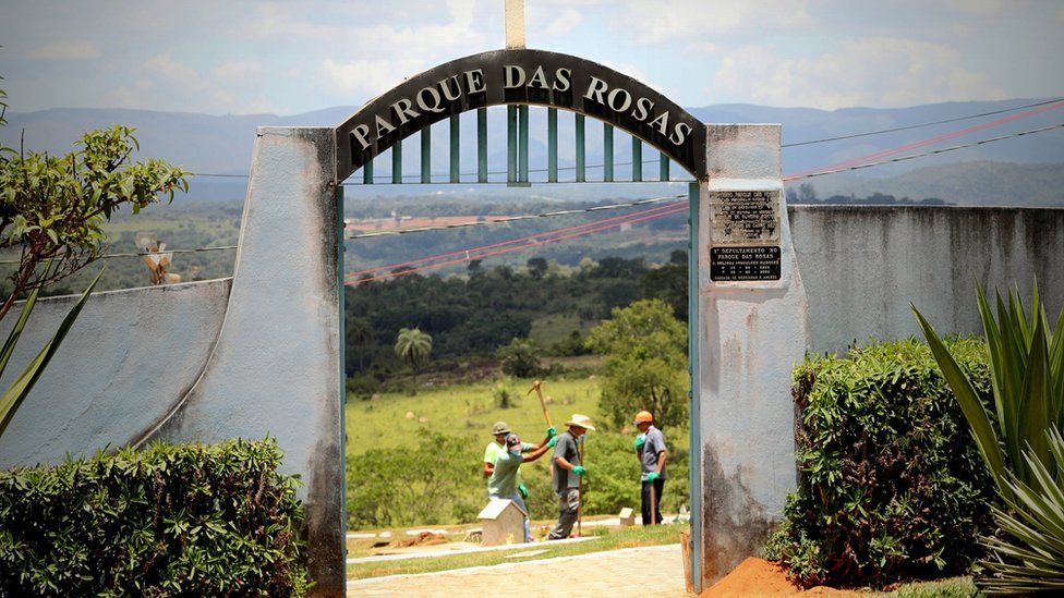 """Workers dig pits to bury the victims of Vale""""s dam accident, at the Parque das Rosas cemetery in Brumadinho,"""