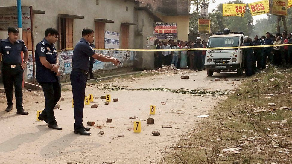 Bangladesh police inspect the site where an Italian priest was attacked at Dinajpur, 415 kilometres (260 miles) north of the capital, Dhaka, Wednesday, Nov. 18, 2015. T