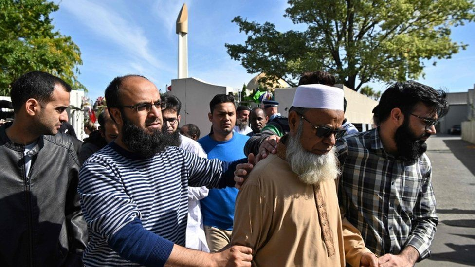 Members of the Muslim community react as they leave the Al Noor Mosque in Christchurch