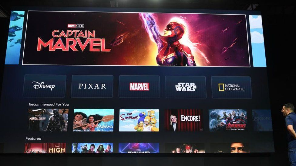 A giant screen shows Marvel's Captain Marvel being promoted on the home screen of the Disney+ app