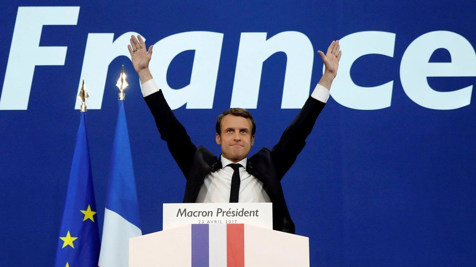 Emmanuel Macron, head of the political movement En Marche !, or Onwards !, and candidate for the 2017 French presidential election, celebrates after partial results in the first round of 2017 French presidential election, at the Parc des Expositions hall in Paris, France April 23, 2017