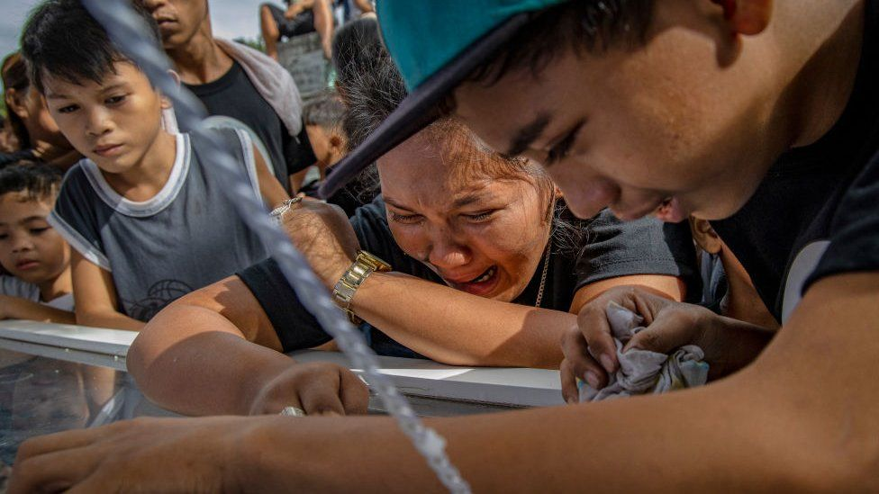 Relatives weep during the funeral of 23-year-old Jaybee Castor on July 18, 2019 in Manila, Philippines.