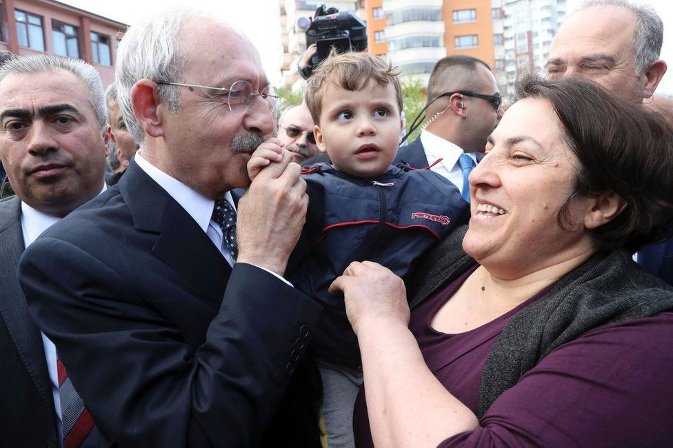 """The leader of Turkey's main opposition Republican People""""s Party, Kemal Kilicdaroglu, is greeted by supporters outside a polling station where he voted in the constitutional referendum in Ankara, 16 April"""