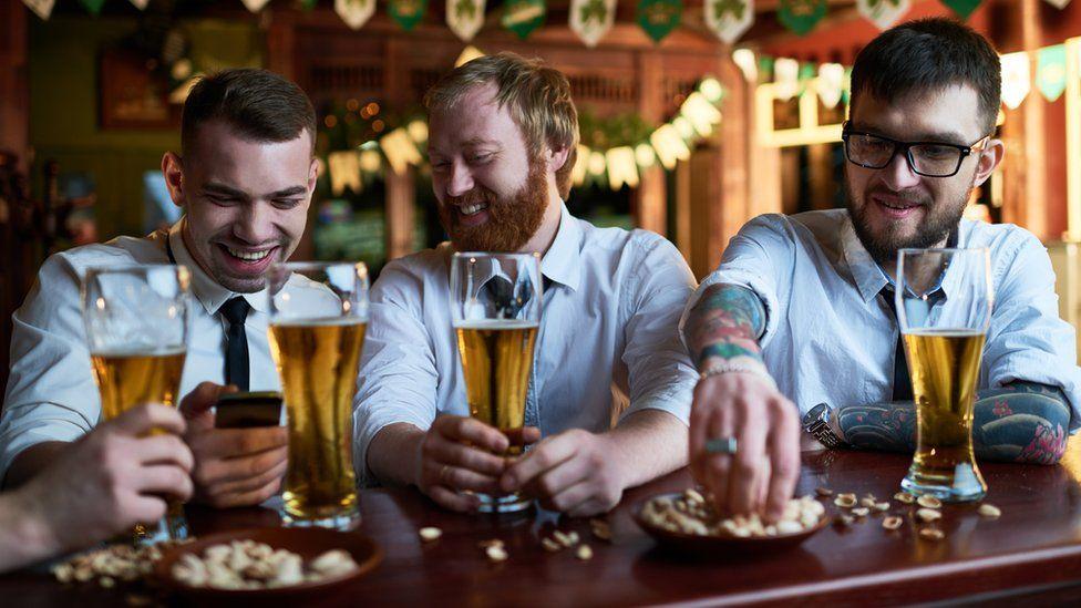 Men drinking alcohol