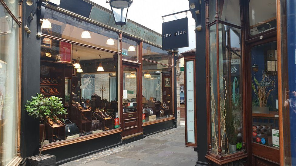Two shops in the centre of the Morgan arcade