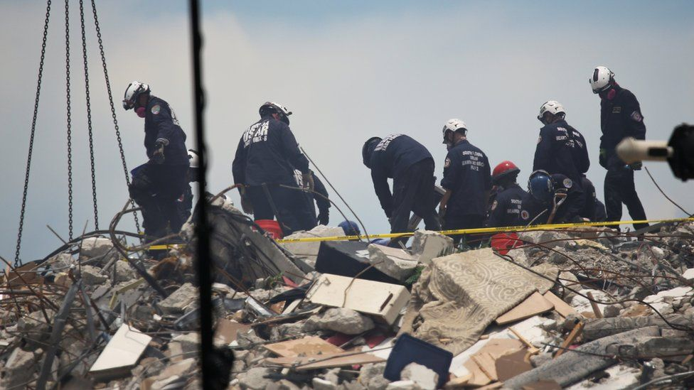 Rescue personnel continues search and rescue operations for survivors of a partially collapsed residential building in Surfside, near Miami Beach, Florida,