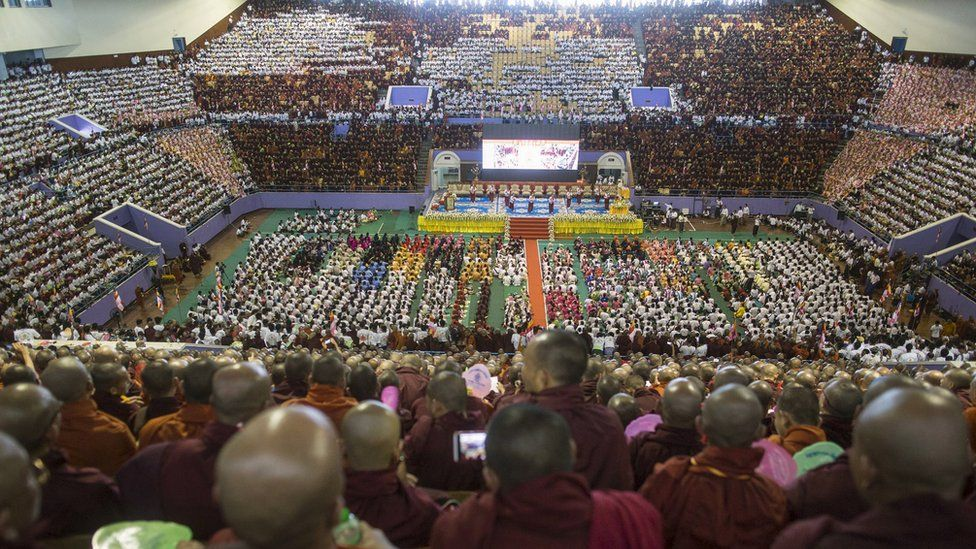 Buddhist monks and supporters celebrate in a stadium at Yangon on Sunday