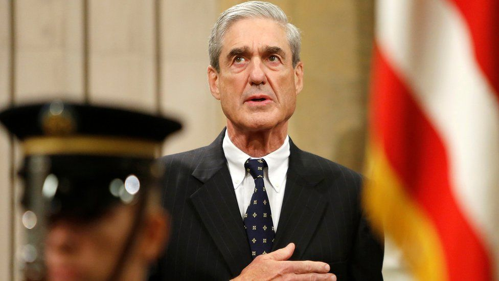 Outgoing FBI Director Robert Mueller stands for the national anthem during a farewell ceremony for him at the Justice Department in Washington, August 1, 2013.