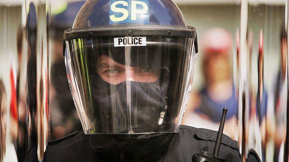 Police officer in riot helmet