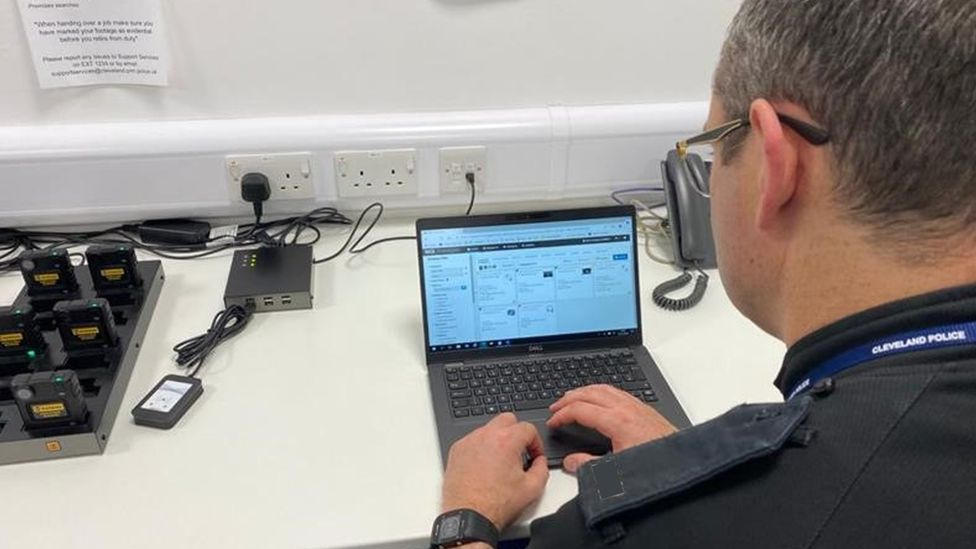 A police officer using Nice's evidence-gathering software