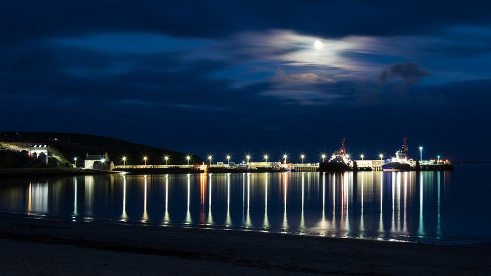 Here's my entry to this week's Pictures of Scotland, Reflections of Scapa Pier, taken by myself near Kirkwall, Orkney.