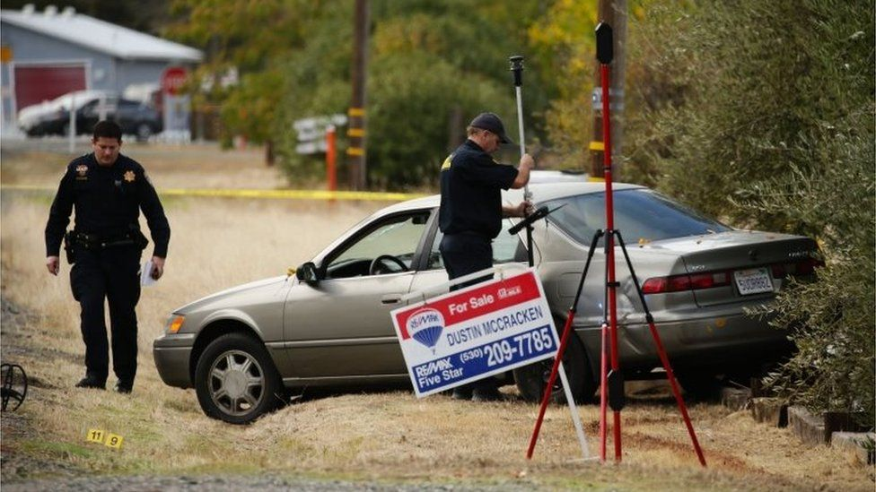 Police examine a vehicle that was involved in the string of shootings in Rancho Tehama