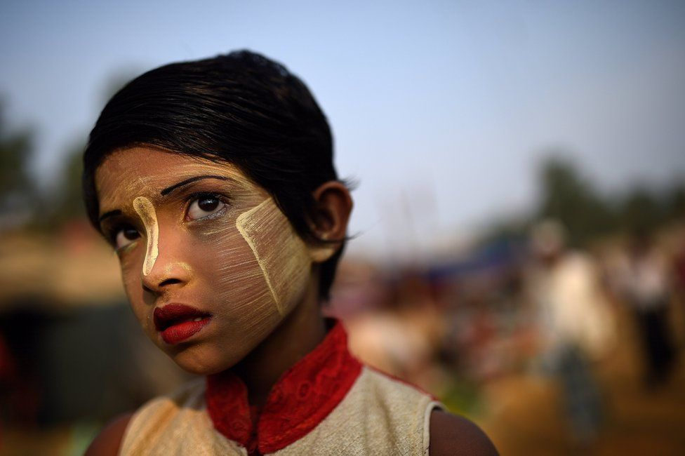 Rohingya refugee girl named Rufia Begum, aged 9, poses for a photograph as she wears thanaka paste at Balukhali camp in Cox's Bazaar, Bangladesh