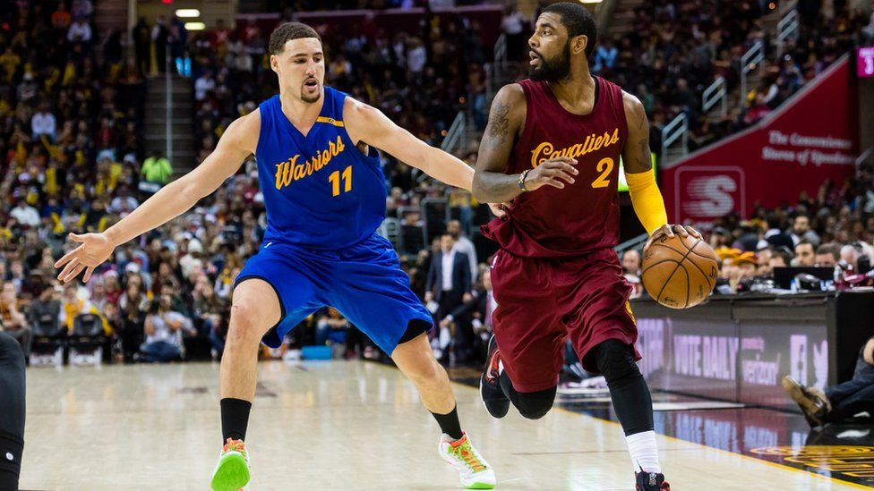 Klay Thompson of the Golden State Warriors puts pressure on Kyrie Irving of the Cleveland Cavaliers during the second half at Quicken Loans Arena on December 25, 2016 in Cleveland, Ohio.
