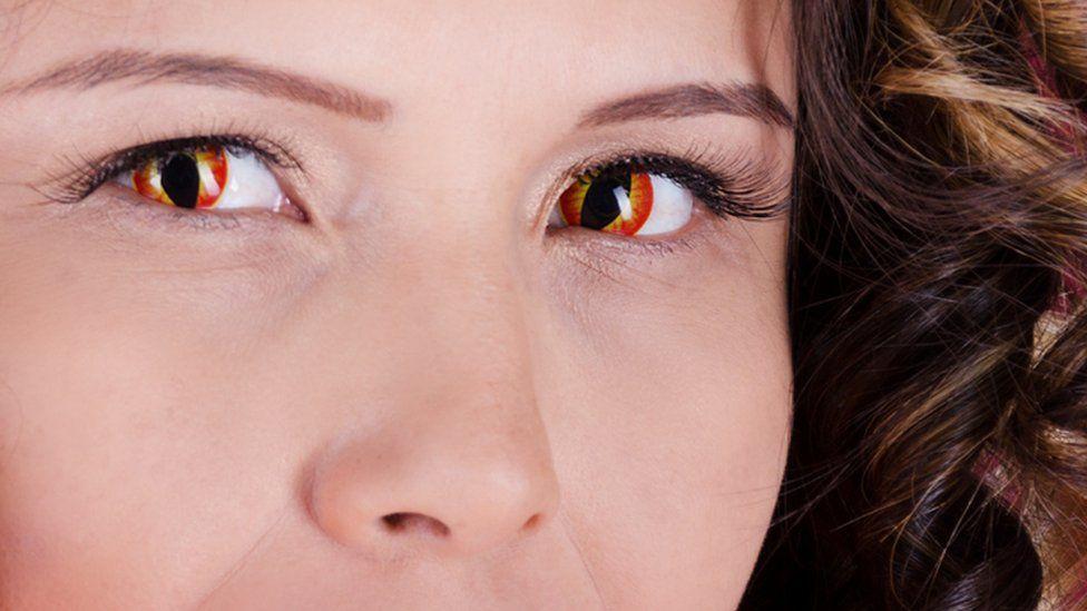 Woman wearing snake eye contact lenses