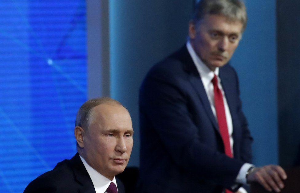 Kremlin spokesman Dmitry Peskov listens as Russian President Vladimir Putin speaks during annual news conference in Moscow, Russia December 20, 2018