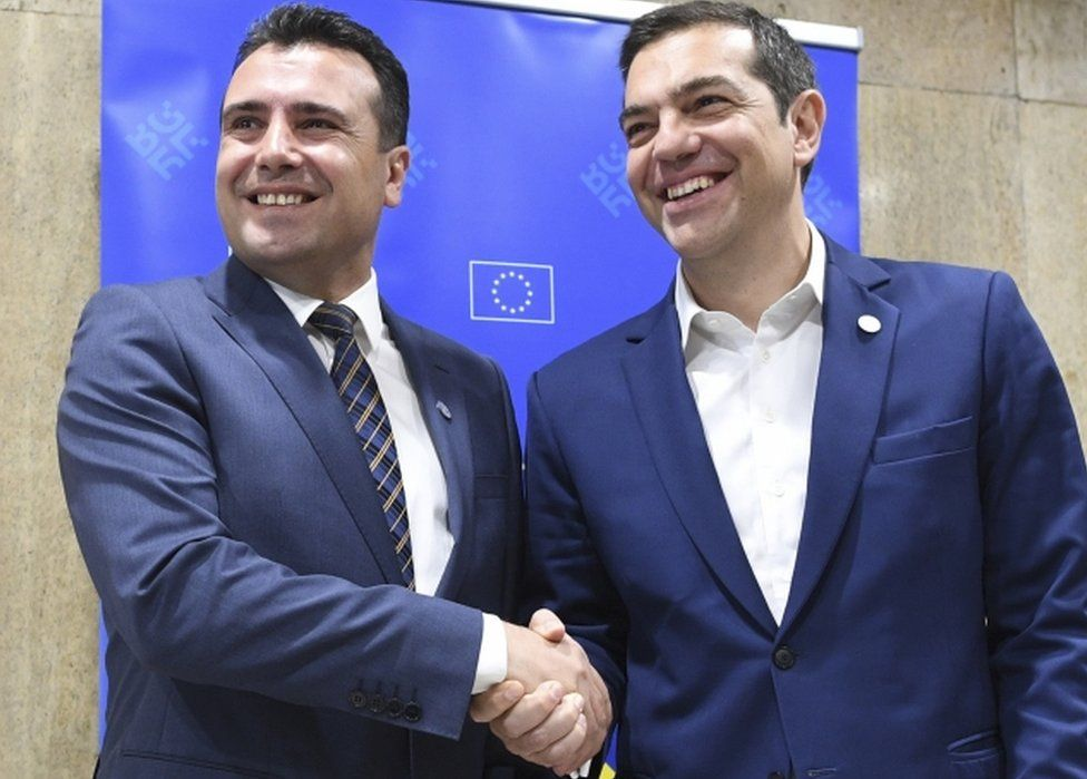 Alexis Tsipras and Zoran Zaev pictured smiling and shaking hands on the sidelines of an informal EU summit