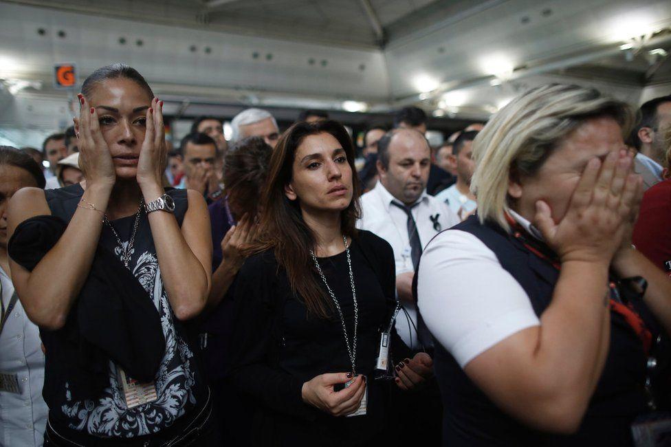 People weep at the memorial ceremony at Ataturk airport, 30 June