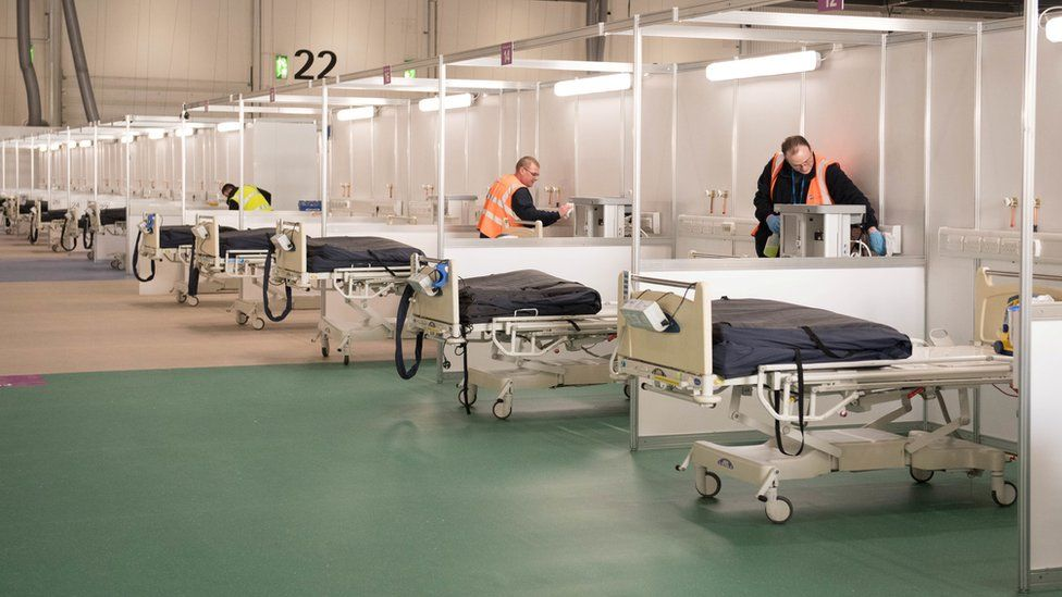 Contractors work at ExCel London, which is being converted into the temporary NHS Nightingale Hospital,