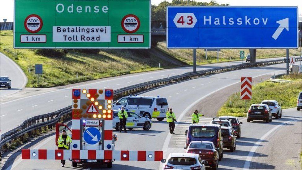 Danish Police set up a barrier before the Great Belt Bridge in Korsoer, Denmark, 28 September 2018