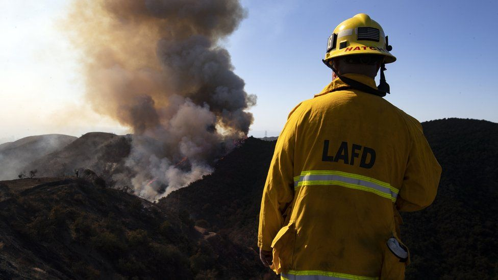 A firefighter looks at the Getty Fire