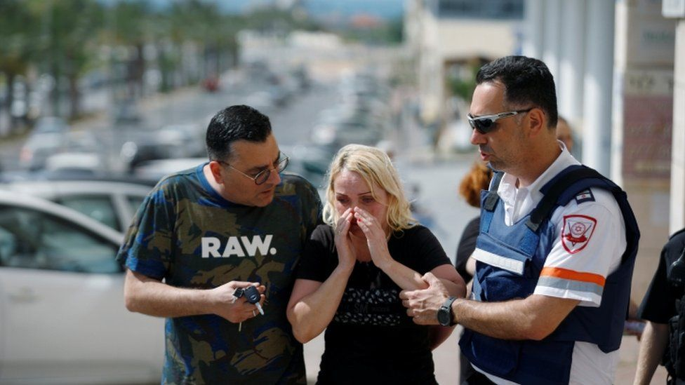 Woman comforted after rocket attack in Ashkelon