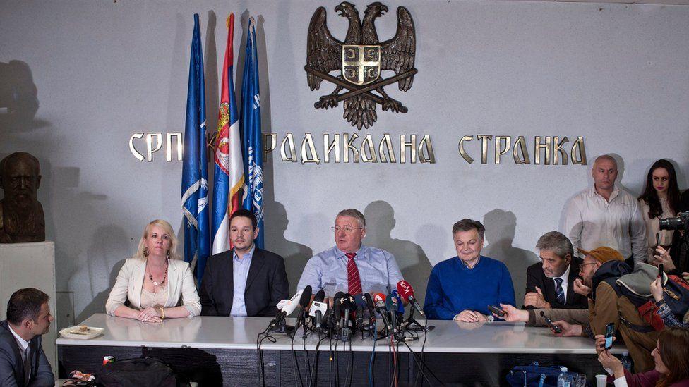 Vojislav Seselj, centre, speaks at a press conference in Belgrade, Serbia (24 April 2016)