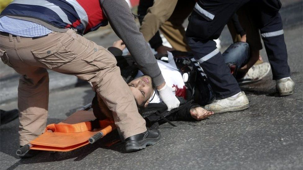 Palestinian medics tend to a wounded Palestinian who is alleged to have stabbed an Israeli border policeman on the outskirts of Ramallah (15/12/17)