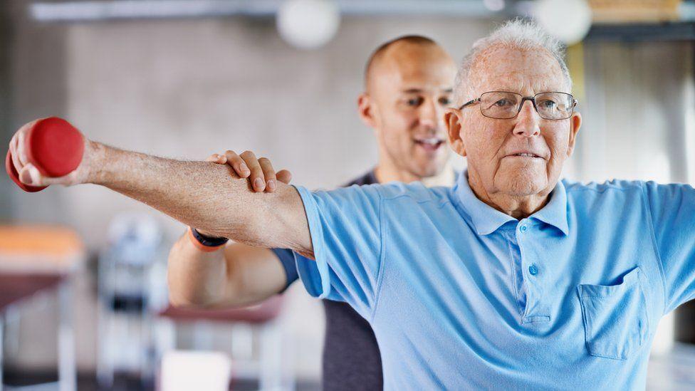 An elderly person exercising