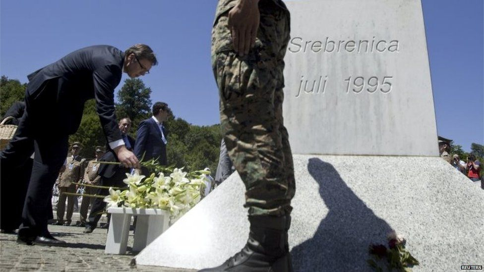 Prime Minister Aleksandar Vucic lays flowers during a ceremony marking the 20th anniversary of the Srebrenica massacre in Potocari