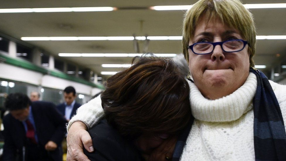 """Relatives react to the sentence read by the judges of the Third Court of Rome during the trial of South American military officers and civilians accused of collaborating in the forced disappearances and murder of Italian nationals, in a US-backed regional plan dubbed """"Operation Condor """", Rome on January 17, 2017"""