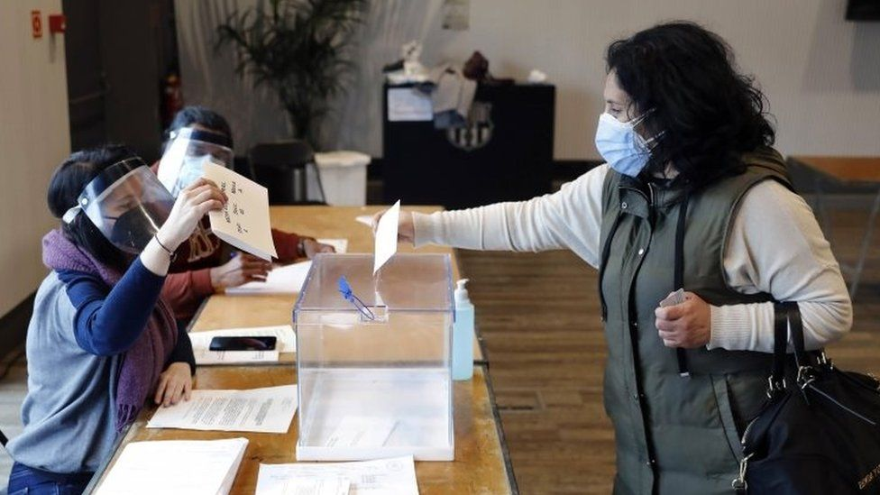 A woman casts her ballot at a polling station in Barcelona. Photo: 14 February 2021