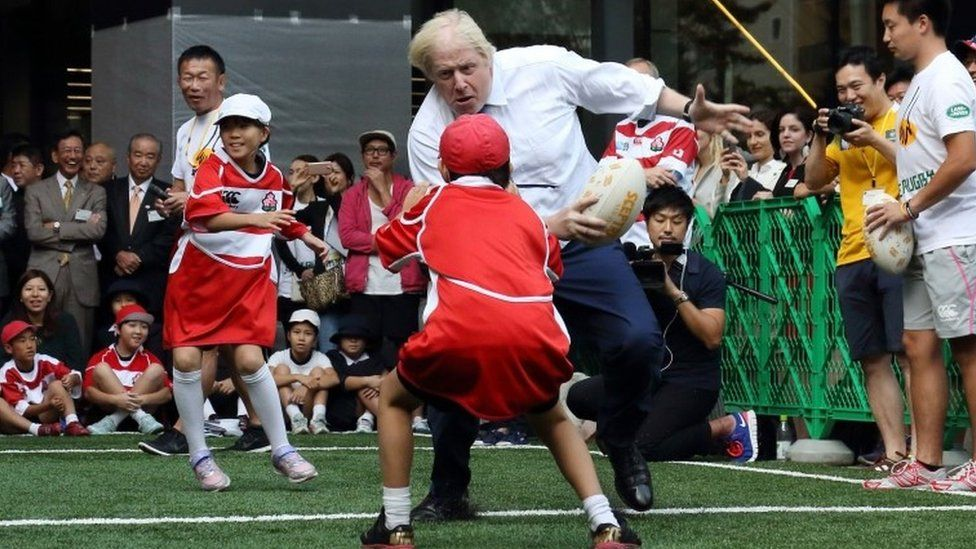 Boris Johnson playing rugby in Japan
