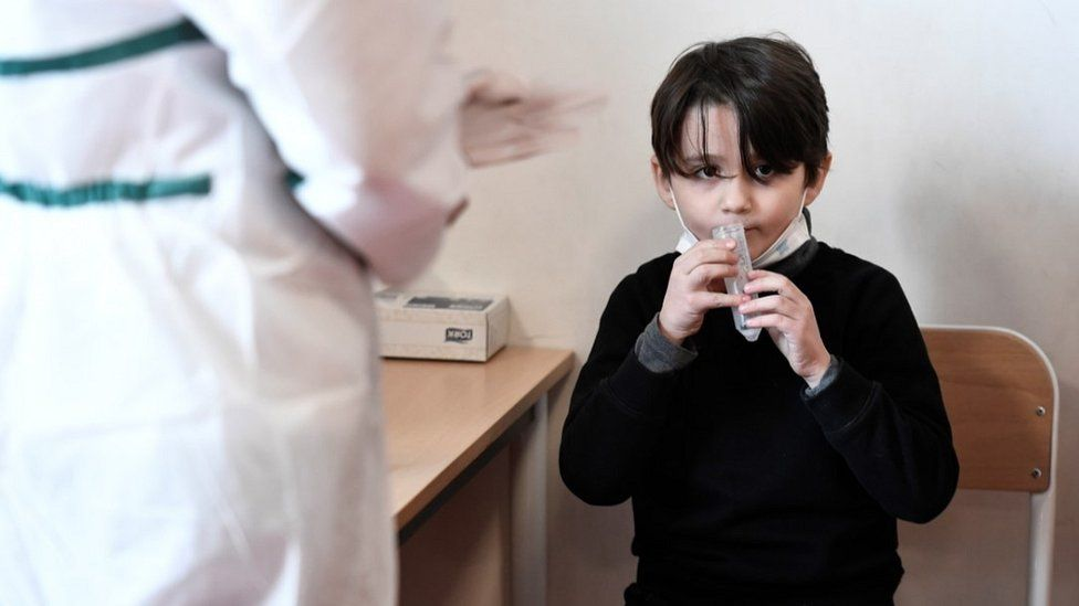 French boy giving saliva sample for Covid test, 11 Feb 21