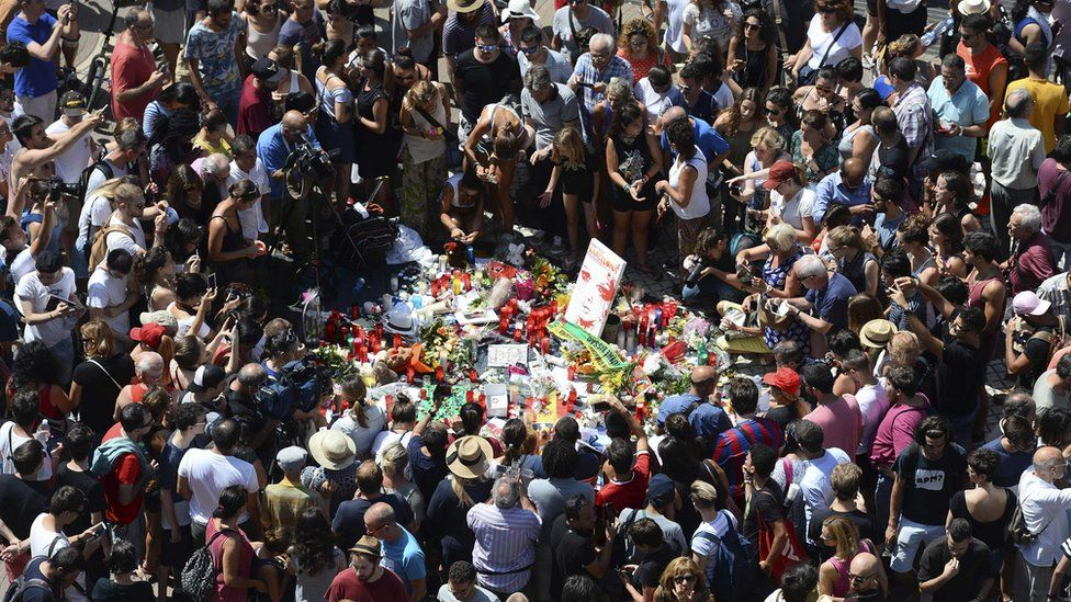 Hundreds of people gather in Barcelona to leave tributes to those killed in the attack