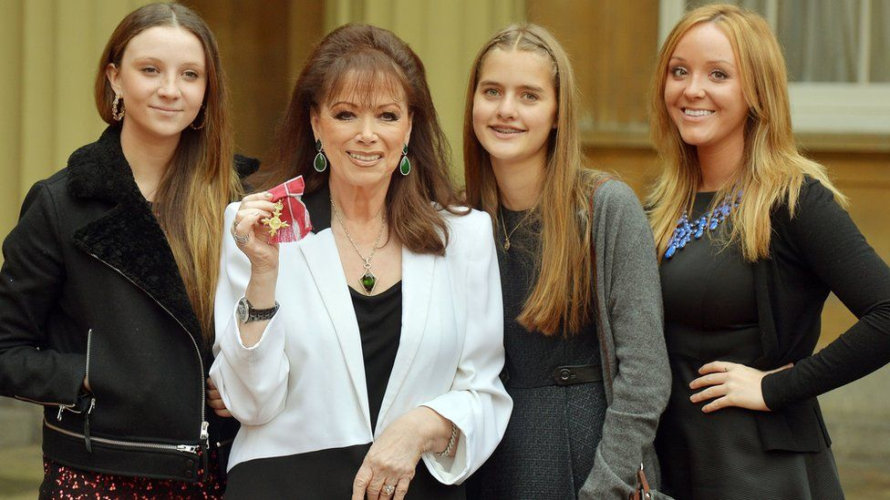 Jackie Collins with her granddaughters, receiving an OBE at Buckingham Palace in 2013